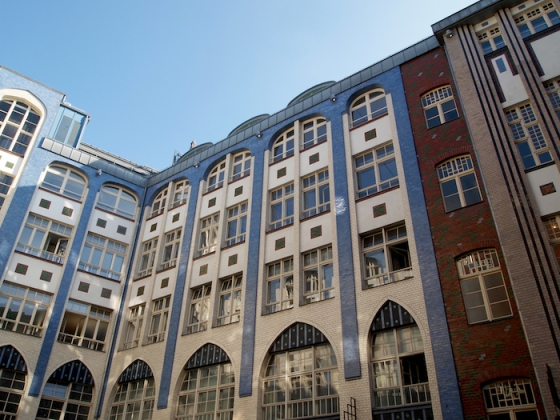 One of a string of courtyards in East Berlin surrounded by beautiful buildings with tile facades.